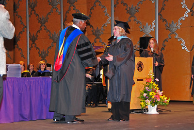 Barb recieves her diploma from the President of Rockford College