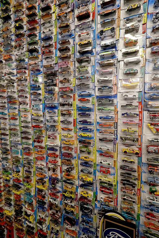 . Dave LaPlante owner of Big D\'s Auto Detailing in Fitchburg likes cars but also has a love for vintage toy\'s. At his shop in Fitchburg in a back room is where he keep many of the toys he has collected.  This is his wall of Hot Wheels. SENTINEL & ENTERPRISE/JOHN LOVE