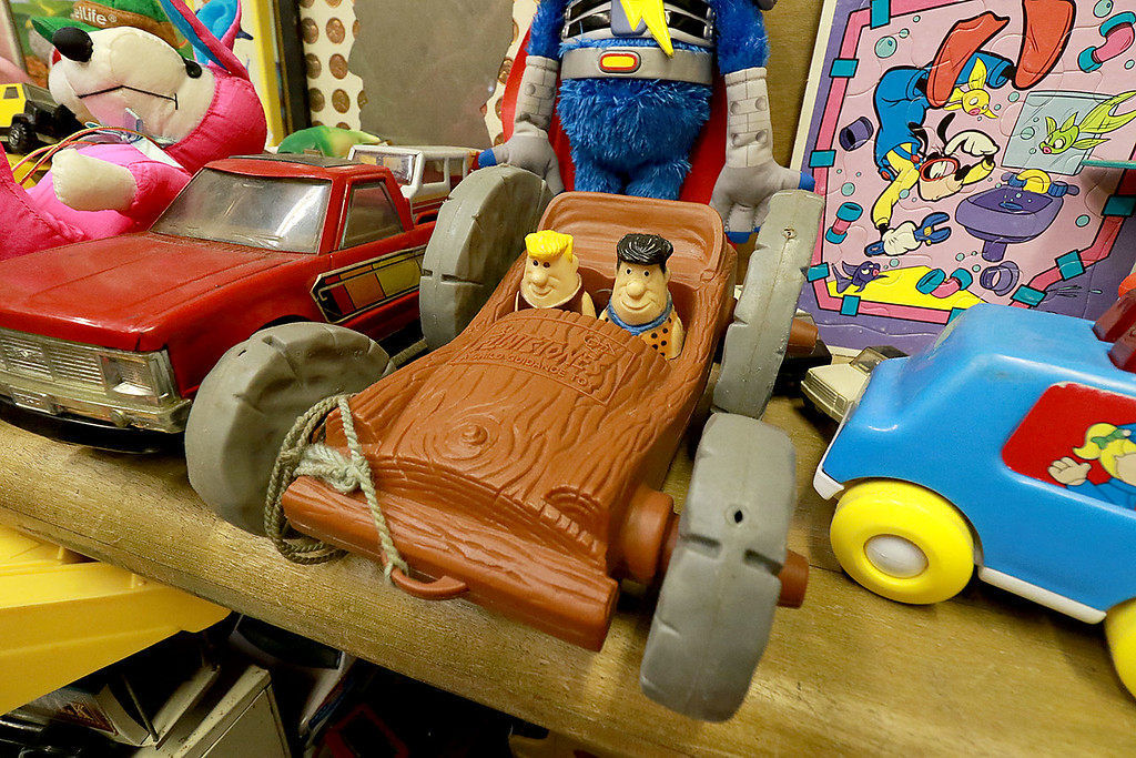 . Dave LaPlante owner of Big D\'s Auto Detailing in Fitchburg likes cars but also has a love for vintage toy\'s. At his shop in Fitchburg in a back room is where he keep many of the toys he has collected. This is a Flintstones car with Barney and Fred .  SENTINEL & ENTERPRISE/JOHN LOVE