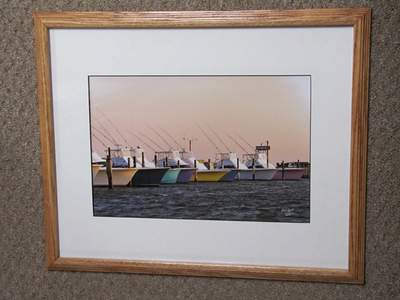 """Title: """" Docked At Sunset """" - Framed Place: OBX - Oregon Inlet - Manteo NC Size: 16x20 Professionally Matted And Framed Price: $119 plus VA sales tax and shipping Buy This Item: http://www.etsy.com/listing/90539646/obx-oregon-inlet-manteo-nc-framed-fine   ~Want this as a print on a 5x7 Note Card? http://www.etsy.com/listing/71810088/note-cards-5x7-choose-any-photo-or-paper  ~ Want this as a print on a jewelry pendant? http://www.etsy.com/listing/74448914/cape-hatteras-lighthouse-fine-art  ~ Special Custom requests welcome.....just email me and I will do my best to work with you. If you have a theme or particular interest I am sure I have photography for you.  ~Visit our shop to see all of our hand cut Scherenschnitte Art, Fine Art Photography, Bookmarks, Note Cards, Photo Pendants, Jewelry: http://artgalleryriverrd.etsy.co   ~All images are copyright protected and the exclusive property of Dave Lynch and may not be used without permission. ~Frames may vary slightly depending on available stock"""
