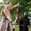 "Kiersten Hansen, dressed as Rey, spars with Oscar Auflick, 6, dressed as Kylo Ren, following a Star Wars costume contest held before an outdoor screening of ""The Force Awakens"" on Bestor Plaza Tuesday, July 19, 2016."