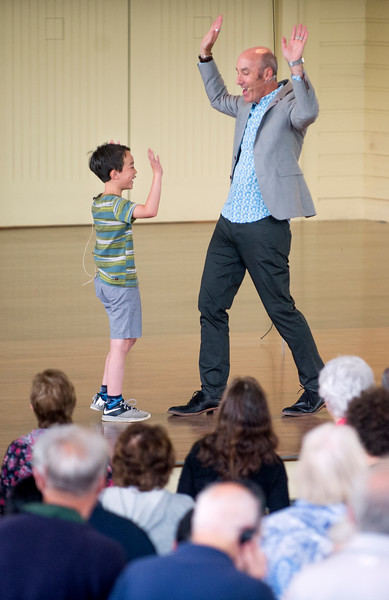 Stanford d.school co-founder and executive director George Kembel and his son Carter, 8, lead the audience in a group activity during Kembel's lecture on innovation Thursday, June 29, 2017 on the Amphitheater stage.  DAVE MUNCH/PHOTO EDITOR