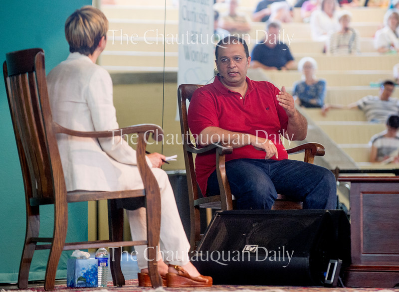 """Kareem Ibrahim is interviewed by Michele Dunne after delivering his lecture """"Cairo: The Arab Megalopolis"""" Wednesday, Aug. 3, 2016 on the Amphitheater stage."""
