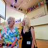 Linda Connell, left, and Cindy Mando talk on the Amphitheater stage while touring the facility during a celebration of the conclusion of the Promise Campaign June 23, 2017. DAVE MUNCH/PHOTO EDITOR