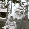 Betty Jean Shaw - 1928 - Age about 7 mos (born Dec. 31, 1927) - Whitstran, WA<br /> <br /> Note from Betty Jean:<br /> <br /> Those chubby arms must have meant that the goat's milk was doing its job. I didn't look too happy about sitting out there under the trees, but surely they wouldn't have put me out there if it was too late in the fall.  So I must have been about 6 or 7 months old. There is another picture of me with my three older siblings that looks like it was taken at the same time but I don't know--good Lord, that was over 84 years ago!  I don't remember?