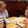 Betty Jean Yaden - 2016 (Aug) - Age 88 - Grandma Betty discusses the menu at Perkins Restaurant with great grandson Eli Yaden (age 8 mos) - Loveland, CO - Eli is the son of Jacob & Kristi Yaden - Photo by Julie Yaden
