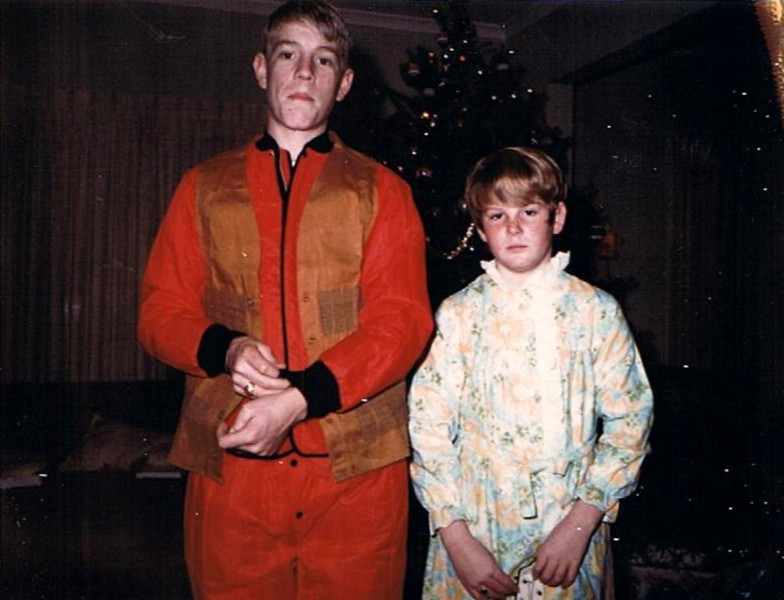 Mark Yaden (age 14) & Pauli Yaden (age 12) - 1970 (Dec) - Selah Farmhouse - Selah, WA<br /> <br /> Notes:<br /> <br /> Dan --- Hey Mark & Pauli, what year was this? And was the photo taken before or after Santa left you the lump of coal?<br /> <br /> Pauli --- I'm thinking maybe 5th-6th grade for me.  Thanks for the memories Dan...I thought I'd gotten over that hair cut!!!<br /> <br /> Mark --- Looks like I was rolling that coal in my mouth... My best guess is that was about 1970 when I was about 14 years-old.  I remember getting the red long underwear and vest for those hunting trips!
