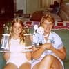 Pauli (left) & Betty Yaden - 1977 - Showing off their tennis tournament spoils - Selah farmhouse - Selah, WA