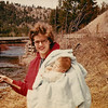 Nancy (age 28) & Darby (about 3 mos) Shaw - 1965 - Somewhere in Western Montana<br /> <br /> Note from Lorena Garza:<br /> <br /> I love this picture of Mom!  Darby was born 02/26/1965 so she was 28 in this picture - turning 29 in December.  I am not exactly sure where this picture was taken but Mom was/is a fishing fanatic and we were on the road alot in those days, looking for the best spots.  We must have been to every good fishing hole in western Montana at one point or another. Darby was clearly out on the water early -- he must be about 3 months in this picture.