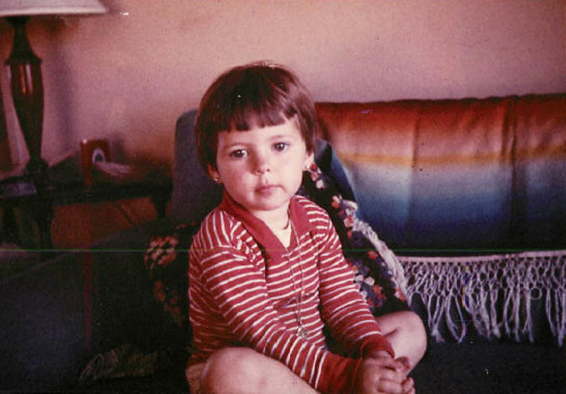 Lorena Garza - Circa 1963<br /> <br /> Note from Lorena:<br /> <br /> I liked to daydream even back then! I think this was about 1962 or 63.  Looks like maybe this was the first place we lived in after moving to Missoula, Montana. Notice your Uncle Bernard's tobacco can on the table in the back - frequently seen in many of our family pictures during the early days.