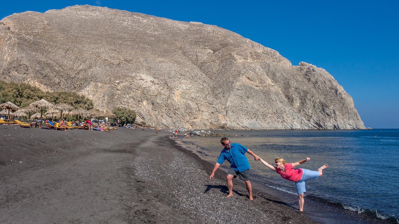 Playing around at the Black Beach in Santorini.