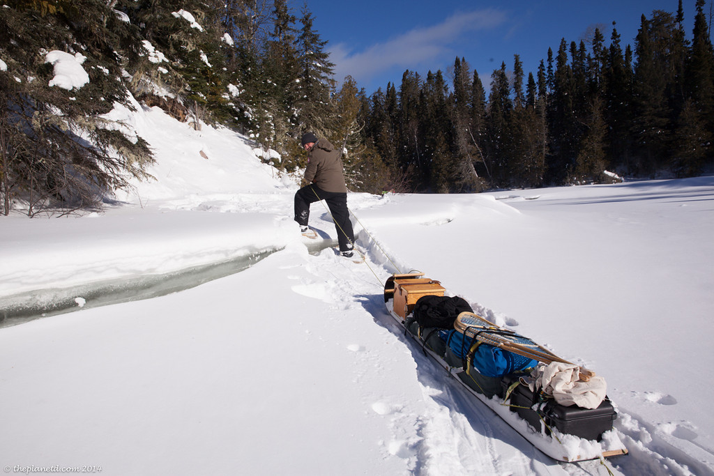 winter trekking with sled on ice