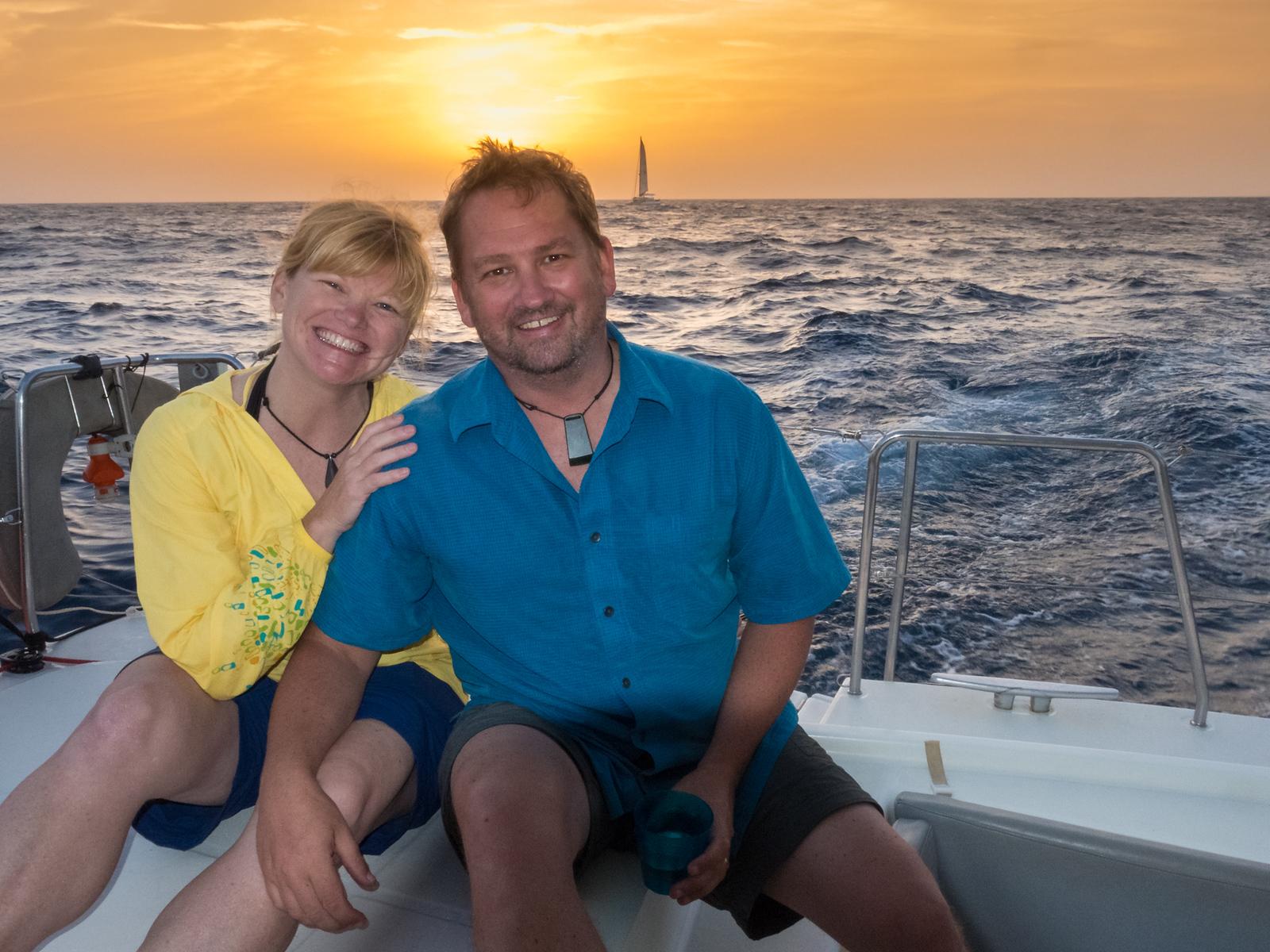 Enjoying the sunset from a catamaran.