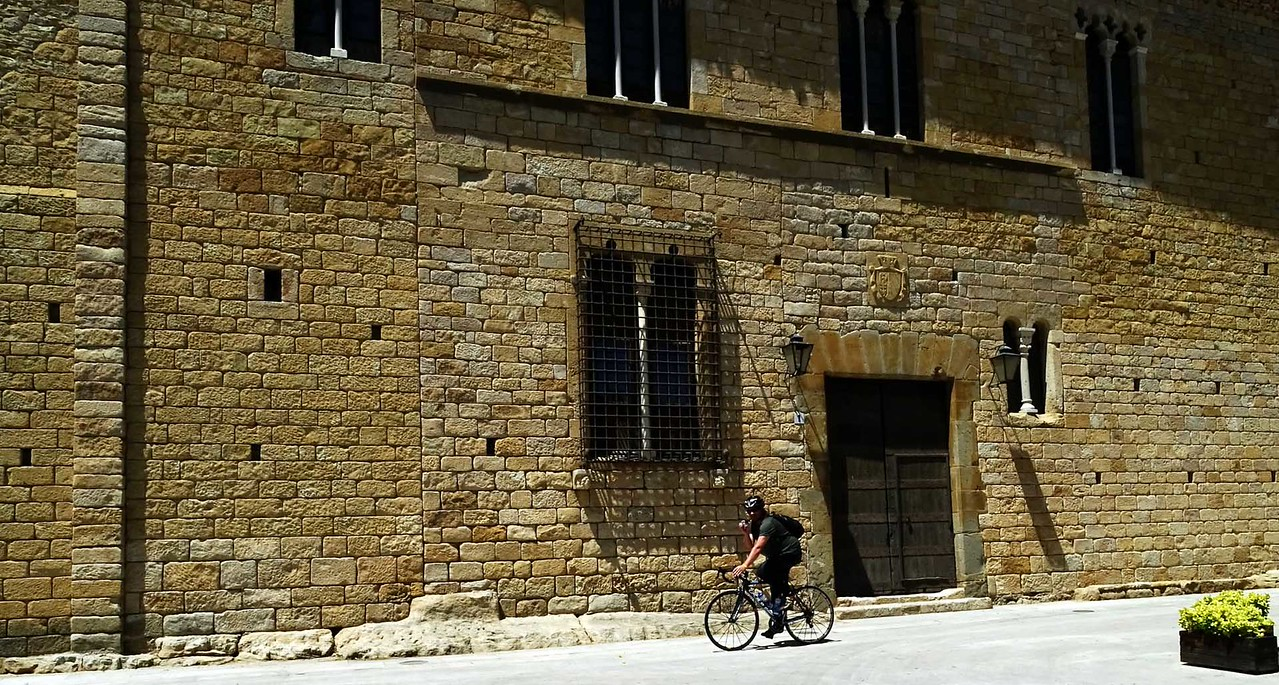 cyclist in front of medieval structure
