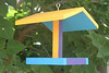 """This is a bird feeder for your garden.  Just add seed and watch the brids flock to your garden.  The tray is 8"""" x 8""""."""