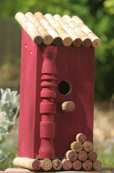 "Country Wine Birdhouse - This functional birdhouse is a wine lover's delight designed to attract small birds to your garden.  The roof and floor are made from wine corks.    The roof lifts off for easy cleaning.  The hole size is 1 1/4"", perfect for wrens, finches and other small birds."