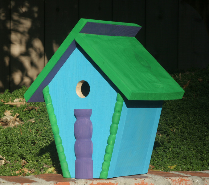 "This Deco Art Birdhouse will attract a number of small birds to  nest in your garden.    Hang it in a tree or under an eave with the hook provided or  hang if on a wall from the hole provided on back.  <br /> The floor is easily removable for cleaning.<br /> Size:  12""h x 9 1/2""w x 7""d"