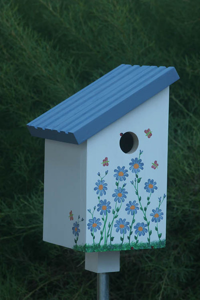 """This charming house will delight any bird. The birdhouse  slides onto a 1/2"""" conduit pole for easy placement in the garden.  The roof is removable for easy cleaning."""