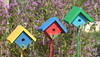 "These small ornamental birdhouses add a splash of color to your garden.  They are 4 1/2"" square and come with a 3' pole, which you easily push into your soil.  They are hand painted with a floral design and they are perfect for people who want birdhouses in their garden, but do not necessarily want to attract birds due to the presence of a loveable dog or cat."
