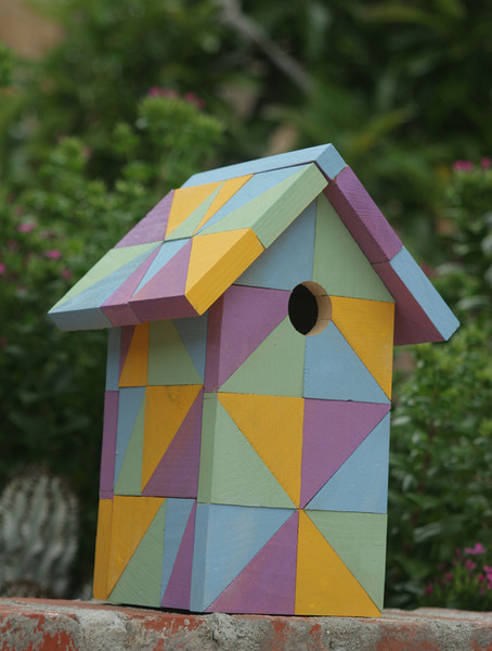 This birdhouse is made from approximately 75 triangles cut to size, painted and assembled.  The house can be made with either a removable floor or roof for cleaning.  Of course, colors are your choice.  I make this house in a variety of sizes to accommodate many of our feathered friends.  You won't see another like this one, I call it Quilters Delight!
