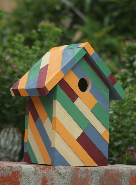 """This colorful birdhouse will be a conversation piece in your garden. Each piece is individually painted, then glued together.   As with all birdhouses, this can be made in colors to suit your fancy.  The entry hole is  1 1/4"""" to attract small Southern CA birds.  The floor is removable for cleaning."""