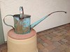 Copper and stainless steel watering can with a repurposed water line spout.