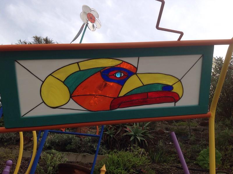 Thunderbird, stained glass and repurposed window