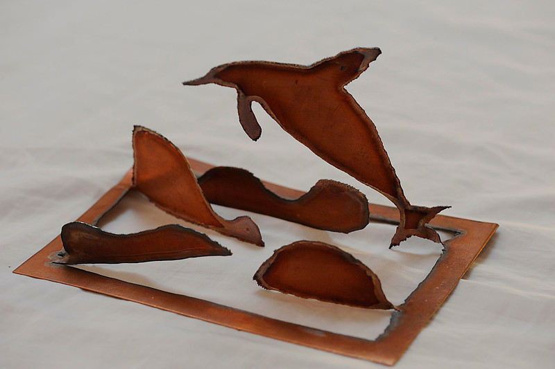 """""""Dolphin""""  is one of my sculpture cards.  They are sheet copper cut to shape and ready for you to unfold.  There is no wrong way."""