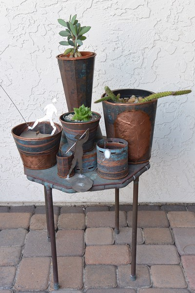 Some vessels made from repurposed copper.