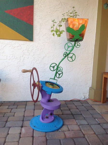 This is an antique serpentine shear that I repaired and modified to make a plant stand.