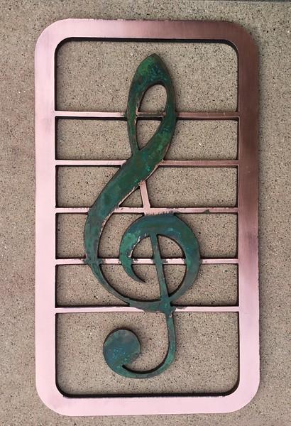 Treble clef, copper with patina