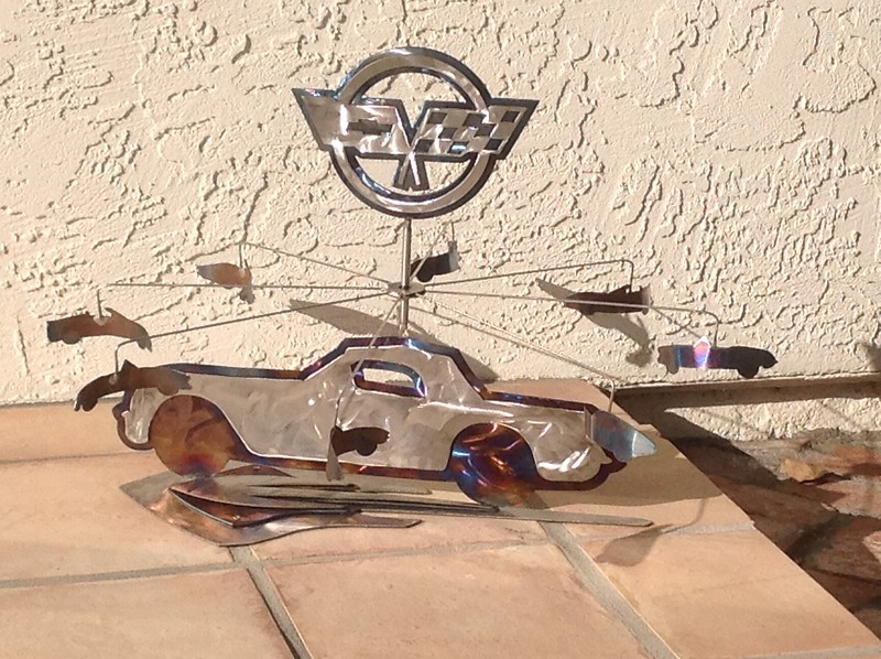 This whirligig is inspired by corvettes, it is a 59 vette and new vette logos.