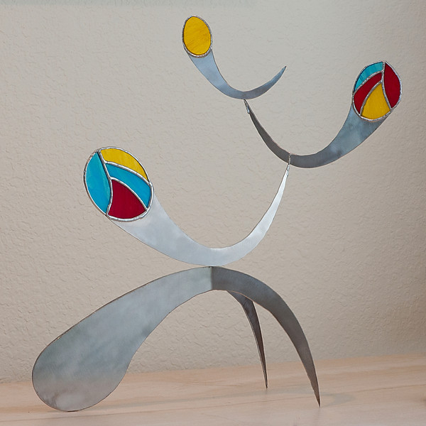 Abstract sculpture combining stainless steel and glass.