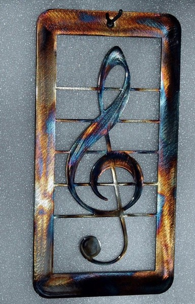 Treble clef, steel heat colored