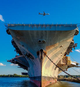 This is CV-67 (USS John F Kennedy) at the Naval Inactive Ship Maintenance Facility (aka the Philly Navy Yard) - right in the landing pattern for this American flight into Philly. This is the coolest place, you can walk right up to these massive ships, just don't walk on them! This whole complex seems to slowly being rented out to businesses using the old buildings in very creative ways.