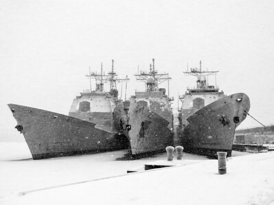 3  Ticonderoga Class Cruisers in the snow tied up at the Naval Inactive Ship Maintenance Facility aka The Navy Yard in Philadelphia.   I believe one of these is the USS Ticonderoga and another is the USS Yorktown but I'm not sure what the 3rd one is.  They are all slated to be disposed of.