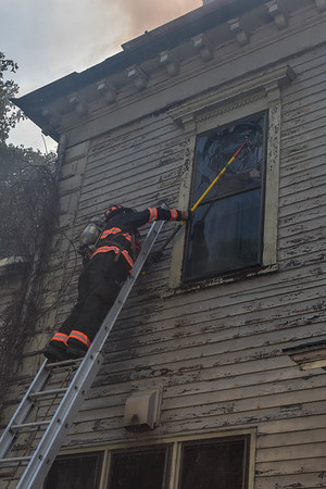 Fitchburg Fire Lieutenant Robert DaCosta vents a window on the C side of the building.