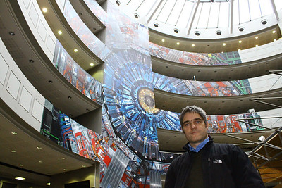 Physicist/Photographer Michael Hoch in front of his 1:1 photo mural of the CMS experiment.