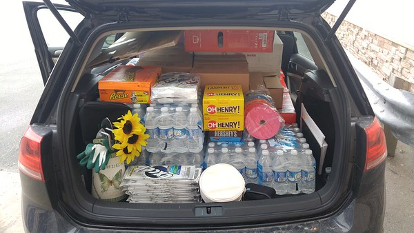 Car loaded with goodies and prizes and heading to the  lanes.