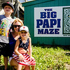 Tyler, 6, Amanda and Amelia Stevens, 4, pose for photos as they await the arrival of David Ortiz for the opening of the 'Big Papi Maze' at Davis Mega Maze on Tuesday morning. SENTINEL & ENTERPRISE / Ashley Green