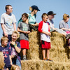 Kids pile up on the hay bails as they await the arrival of David Ortiz for the opening of the 'Big Papi Maze' at Davis Mega Maze on Tuesday morning. SENTINEL & ENTERPRISE / Ashley Green