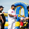 A Big Papi look-alike, Eric Booker of Worcester, entertains the crowd as they await the arrival of David Ortiz for the opening of the 'Big Papi Maze' at Davis Mega Maze on Tuesday morning. SENTINEL & ENTERPRISE / Ashley Green