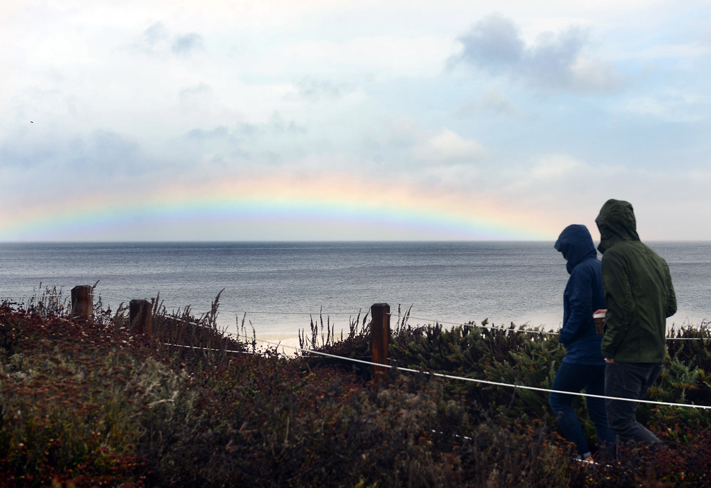 . A rainbow lights up the sky over Del Monte Beach in Monterey as the storm moves through Monterey on Sunday October 16, 2016. (David Royal - Monterey Herald)