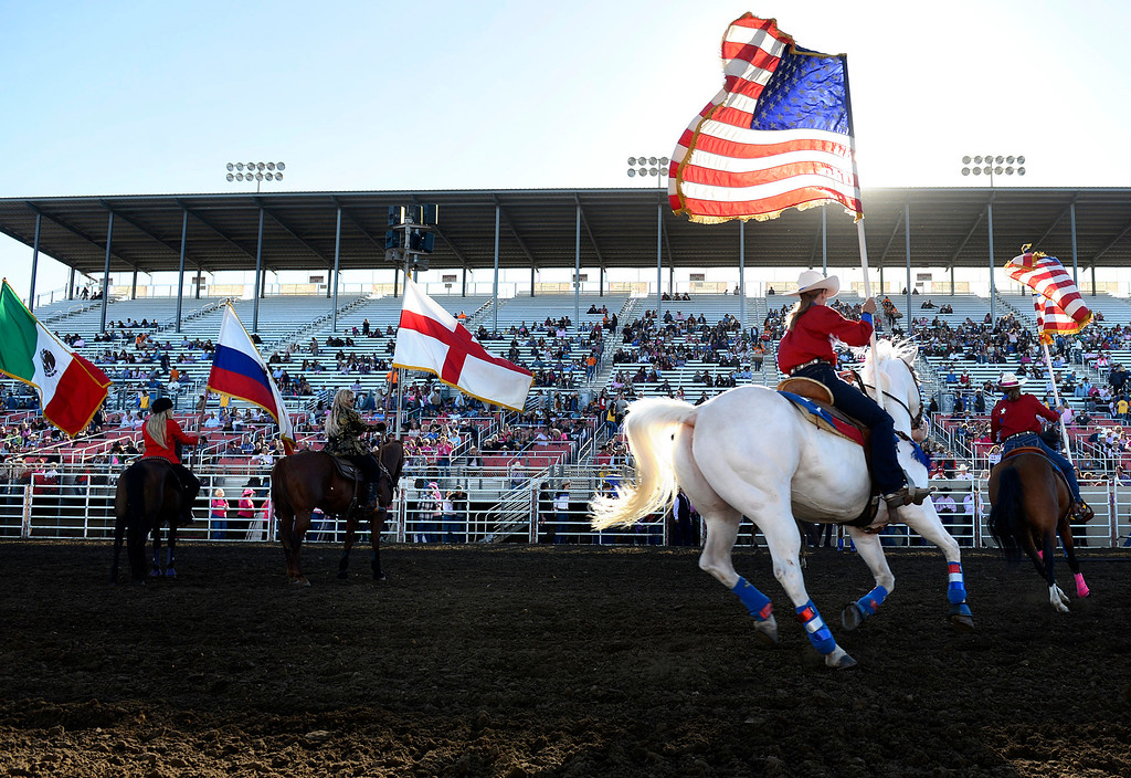 . Pageant of the Flags members carry flags during the start of the California Rodeo Salinas at the Salinas Sports Complex on Thursday July 21, 2016. (David Royal - Monterey Herald)