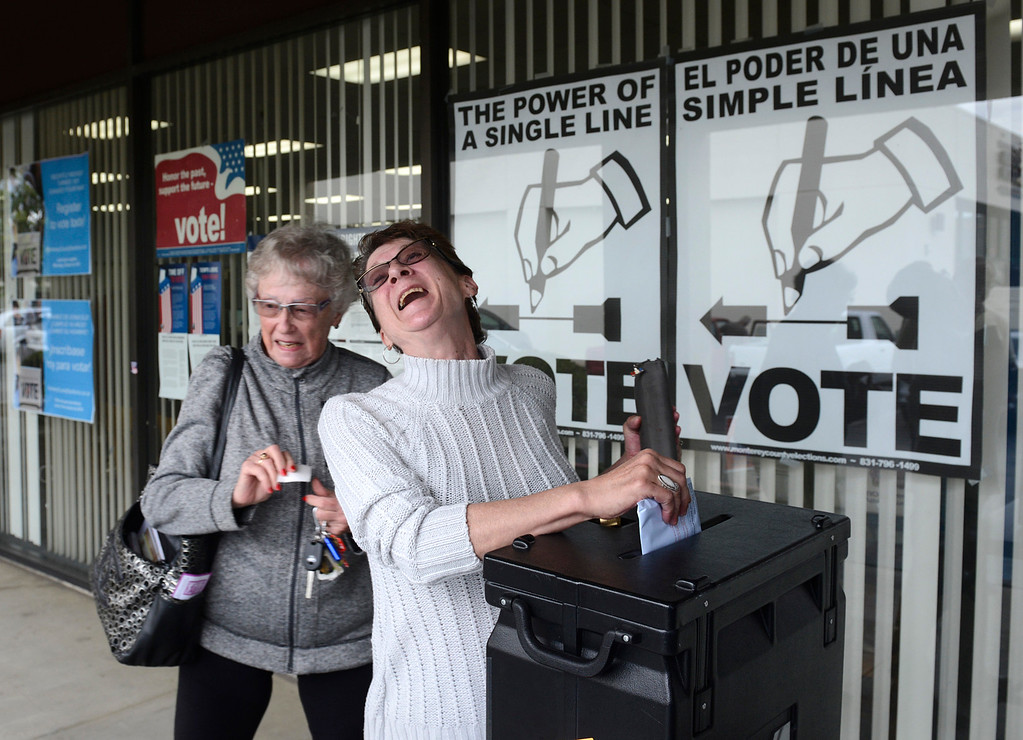 . Trudy Tully, left, and her daughter Donna Tully Rose place their absentee ballots in a collection box outside the Monterey County Elections Department Salinas on Monday October 24, 2016. Monday was especially busy at the office as it was the final day to register to vote and early voting was taking place. (David Royal - Monterey Herald)