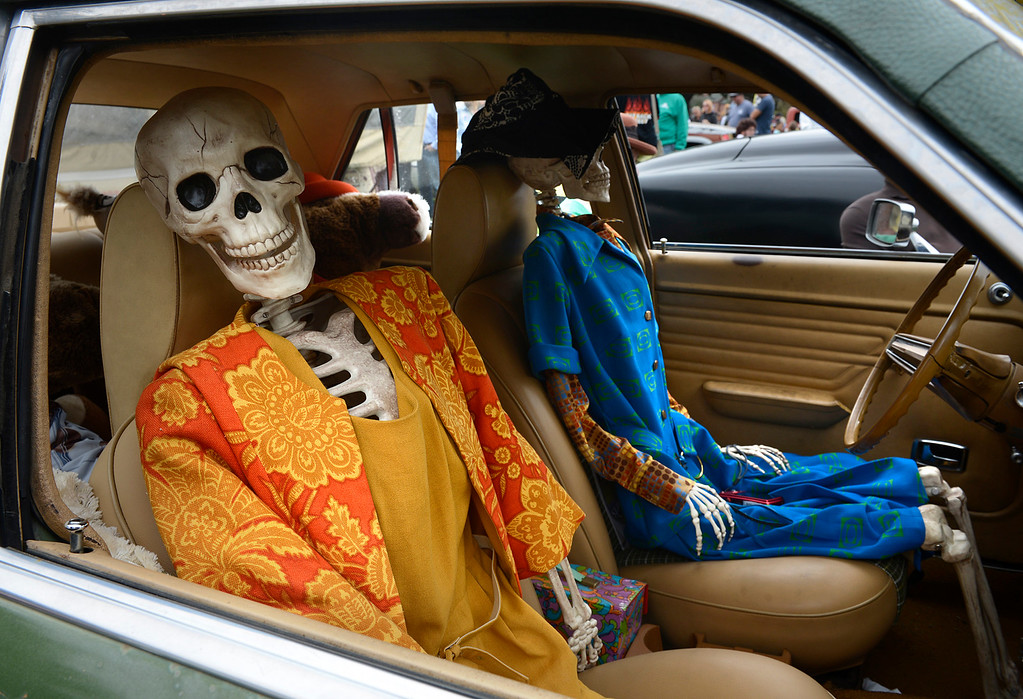 """. Skeletons occupy the front seats of William Hughes\' 1973 Lincoln Mercury Comet dubbed the \""""Vomit Comet\"""" during the Concours d\'LeMons at Laguna Grande Park in Seaside on Saturday August 20, 2016. The event touts itself as \""""celebrating the Oddball, Mundane and truly Awful of the automotive world.\"""" (David Royal - Monterey Herald)"""