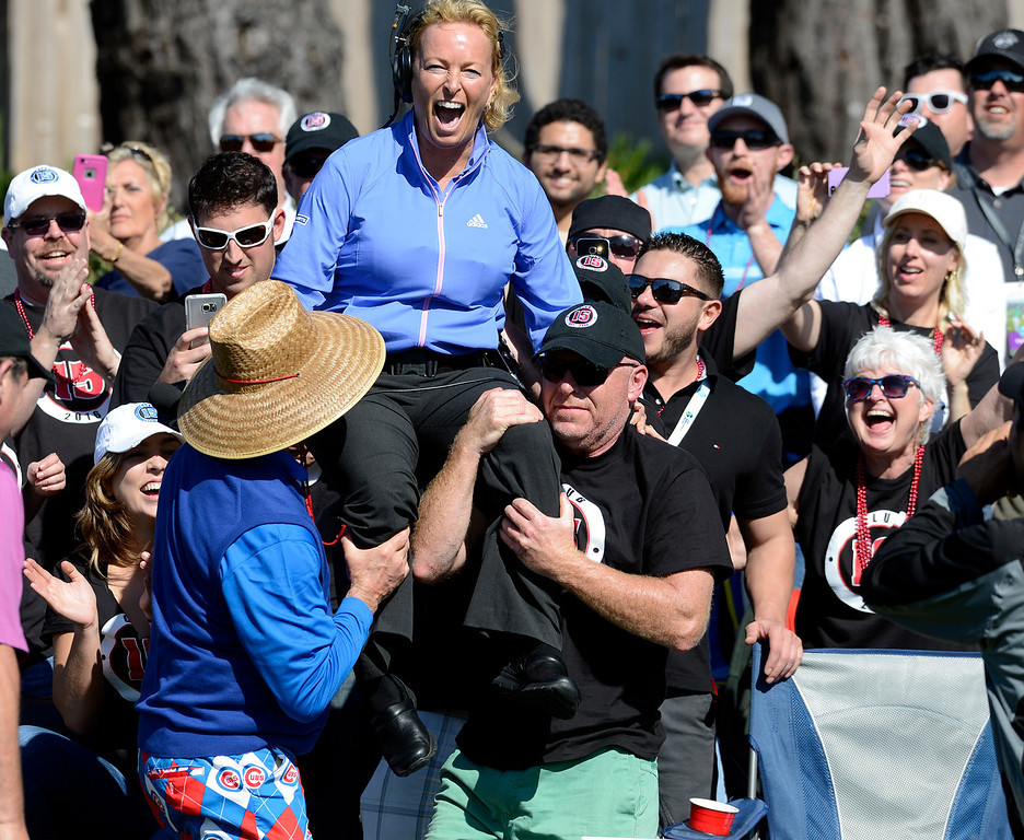 . Bill Murray, left, lifts up CBS golf analyst Dottie Pepper for a crowd surf from Club 15 on the 15th tee at Pebble Beach Golf Links during the third round of the AT&T Pebble Beach Pro-Am Golf Championship on Saturday February 13, 2016. (David Royal - Monterey Herald)