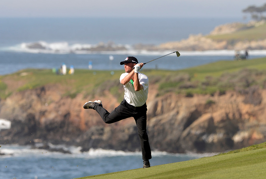 . Spencer Levin hits his second shot on the ninth hole at Pebble Beach Golf Links during first round of the AT&T Pebble Beach Pro-Am Golf Championship on Thursday February 11, 2016. (David Royal - Monterey Herald)