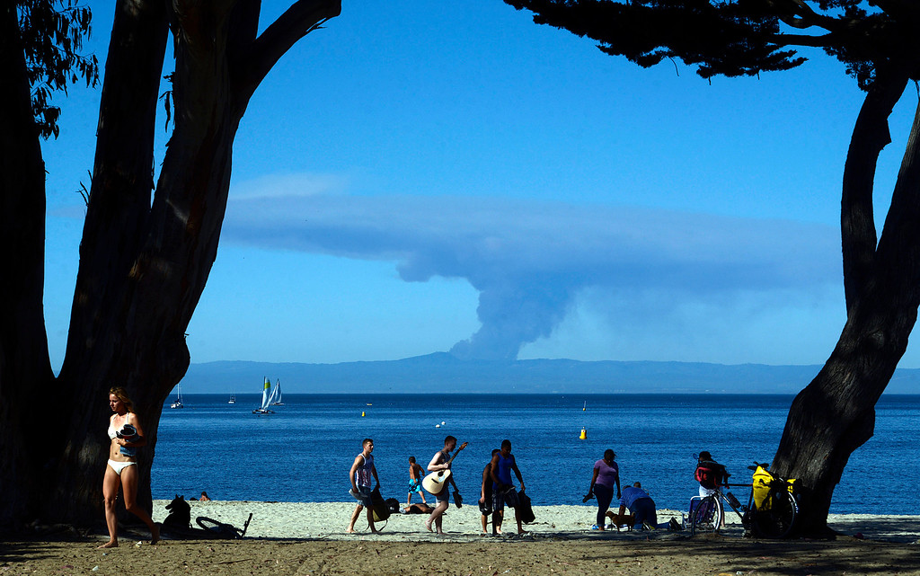 . Smoke from the Loma Fire on Loma Prieta Mountain in the Santa Cruz Mountains is visible from Window on the Bay Park in Monterey on Monday September 26, 2016. (David Royal - Monterey Herald)