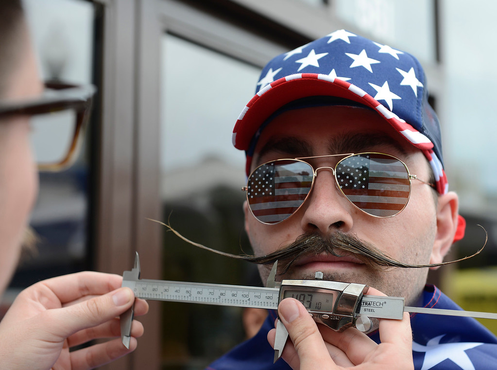 . Preston Flatley has his mustache measured by barber Phill Benson during second annual Mustache Competition the Good Old Days celebration in Pacific Grove on Saturday April 9, 2016. Flatley, who was the defending champion, took third place. (David Royal - Monterey Herald)